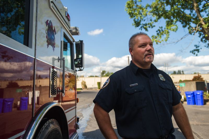 OUTLOOK PHOTO: JOSH KULLA - Gresham Firefighter Jeff Markham remembers feeling frustrated by not being able to help as he watched television coverage of the Sept. 11 terrorist attacks.