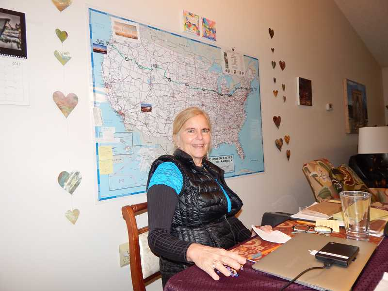 REGAL COURIER PHOTO: BARBARA SHERMAN - In the diining room of their King City home, Sal Strom sits in front of a map of the United States marked with the route of US20 and their stops along the way.