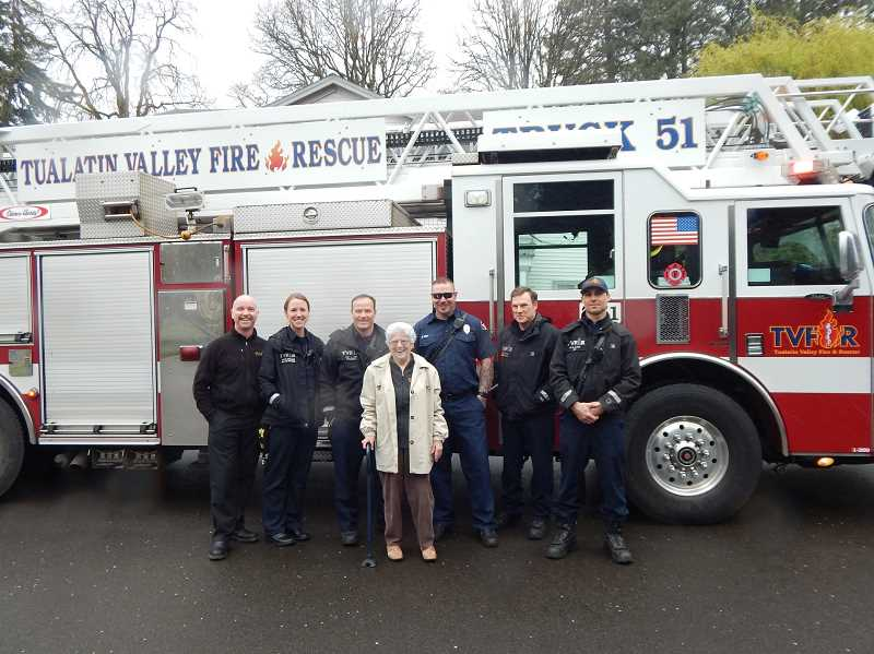 REGAL COURIER PHOTO: BARBARA SHERMAN - Commemorating Patsy Nestor's first ride on a fire engine are (from left) Allen Kennedy, TVF&R division chief; Kim Haughn, public affairs officer; Craig Lyon, Station 51 captain; Nestor; Nathan Kust, firefighter/EMT/driver (aka apparatus operator); Mark Ross, firefighter/paramedic; and Grant Slagle, firefighter/EMT.