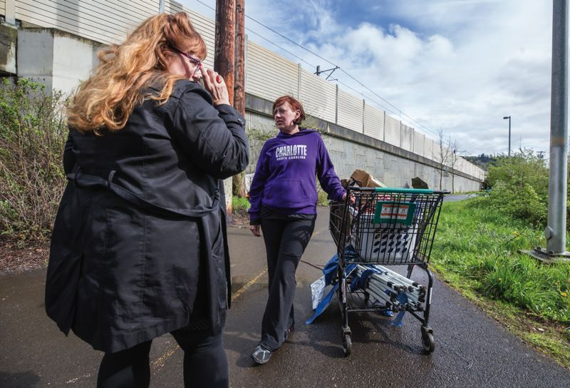 TRIBUNE PHOTO: JONATHAN HOUSE - Lents resident and livability committee member Jennifer Young talks to Grace, a homeless woman finding refuge along the I-205 Multi-Use Path near the Springwater Corridor.