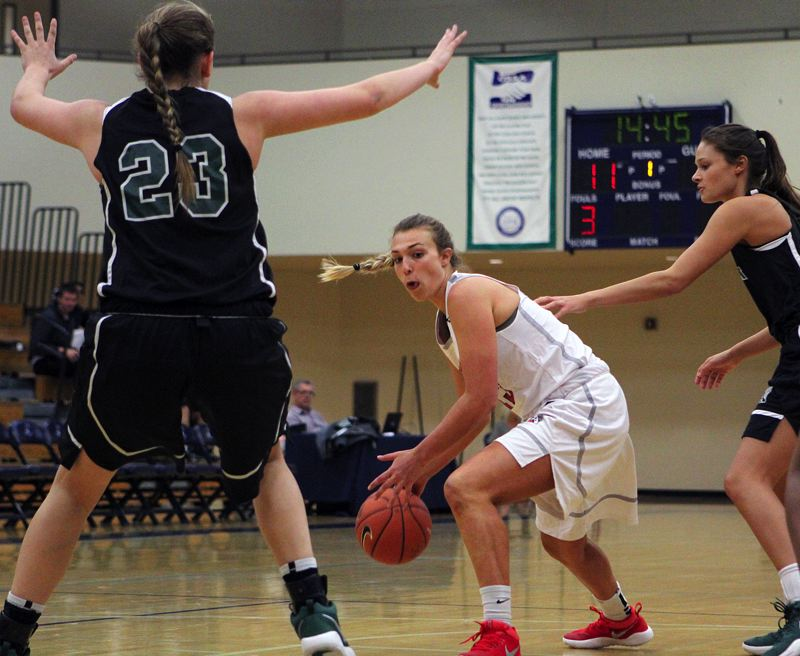 TIDINGS PHOTO: MILES VANCE - West Linn's Kennedy Fulcher looks for room to operate during Oregon's 84-76 win over Washington in the Northwest Shootout on Saturday at Liberty High School.