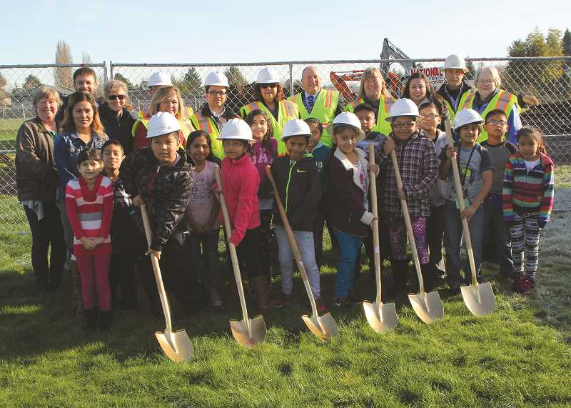 INDEPENDENT FILE PHOTO - The district held a groundbreaking ceremony at Washington Elementary School in December to commemorate the start of construction there. That project has faced delays and is now scheduled to be completed a year later than originally planned.