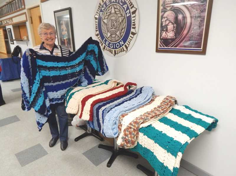REGAL COURIER PHOTO: BARBARA SHERMAN - Kathy Norris, a resident of Royal Villas, brought six lap robes she had crocheted for veterans to the April 11 meeting of the Tigard American Legion Post 158 Auxiliary; Norris said she spends 74 hours making each lap robe, and the veterans really apprceiate them.