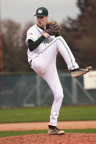 PHIL HAWKINS - North Marion junior Trevor Ensign pitched a complete game and struck out eight in the Huskies' 8-1 victory over the Yamhill-Carlton Tigers last week.