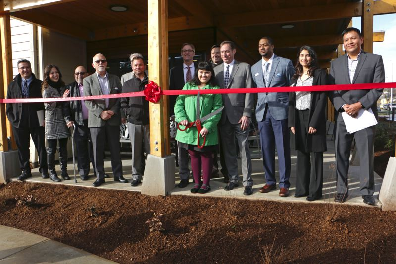 COURTESY GUARDIAN REAL ESTATE SERVICES - Tom Brenneke at the March 23 opening of NAYA Generations behind City Commissioner Dan Saltzman and next to Mayor Ted Wheeler (center, back row).