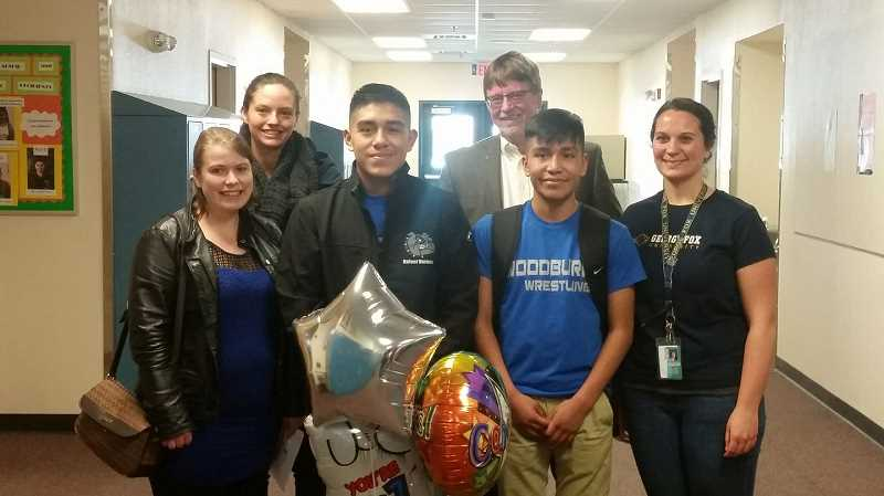 INDEPENDENT FILE PHOTO - Woodburn's 2017 Amazing Kid Rafael Vasquez Lopez (center).