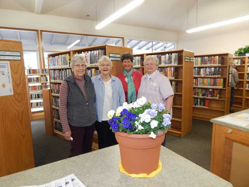 REGAL COURIER PHOTO: BARBARA SHERMAN - KIng City Civic Association library volunteers include (from left) Millie Dettra, Carol Heisler, Nancy Hayes and Judy Holmes, who organized the April 12 open house that drew a lot of newcomers to the library in the Arts and Crafts Building.