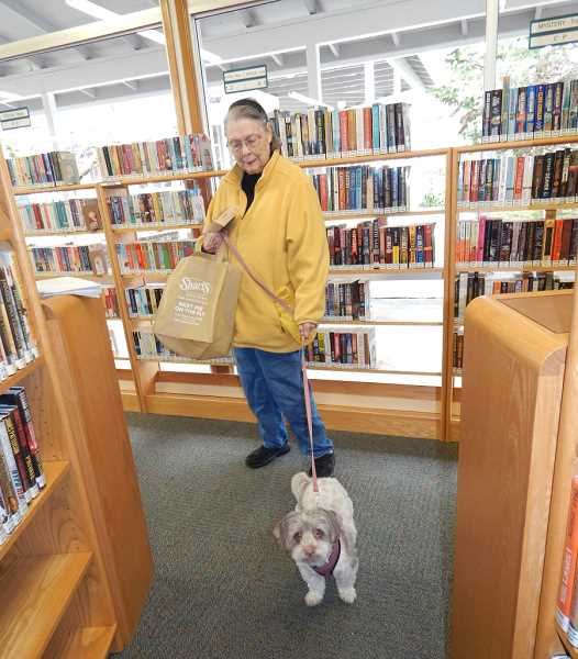 REGAL COURIER PHOTO: BARBARA SHERMAN - KCCA resident Maryann Plath comes to the library every week with her dog Lacey so she didn't make a special trip for the open house.