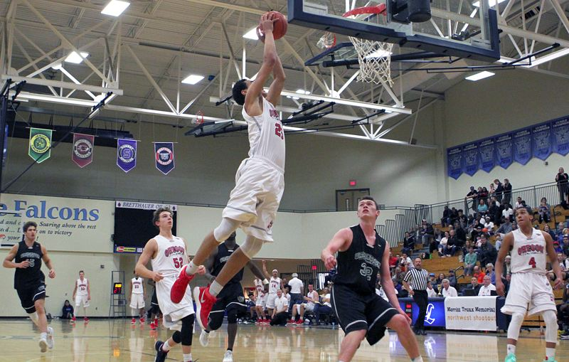 TIDINGS PHOTO: MILES VANCE - West Linn's Khalid Thomas goes up for two of the 32 points he scored in Saturday's Northwest Shootout at Liberty High School. Thomas and his Oregon team won 140-135 in overtime.