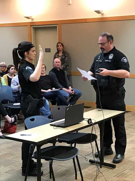 COURTESY OF CAPT. CRAIG DANIEL - Sherwood Police Chief Jeff Groth swears in Officer Bethany Wittig during the Sherwood City Council meeting April 18.