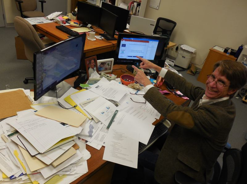 PAMPLIN MEDIA GROUP: JOSEPH GALLIVAN - Corky Collier at his desk at the Columbia Corridor Association.