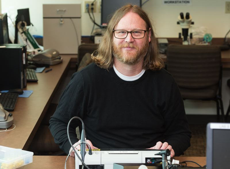 PAMPLIN MEDIA PHOTO: CHRIS OERTELL - Dr. Matthew Bell is a professor of audiology at Pacific University's Hillsboro campus. A musician as well, Bell knows well the damage that can be done to hearing from years of loud music.