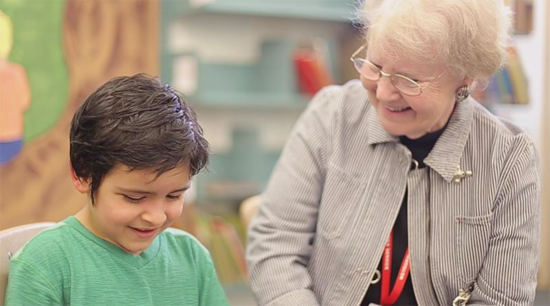 SUBMITTED PHOTO - Lot Whitcomb Elementary School student Angel Gutierrez enjoys learning to read with Herlene Benson, a volunteer mentor.