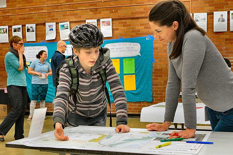 DAVID F. ASHTON - Sellwood Middle School eighth-grader Alec Kimball shows his own route to school to CH2M consultant Kate Drennan.