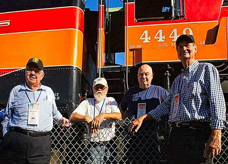 JAIME VALDEZ - American Freedom Train Foundation founder Ross Rowland, engineer Al Phillips, locomotive expert Doyle McCormick, and mechanic Wes Camp stand in front of the fabled diesel engine Southern Pacific 4449, on the Oregon Pacific tracks near Oaks Park.