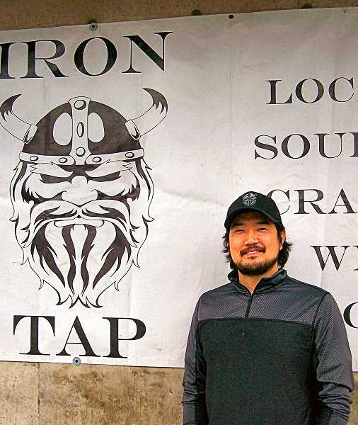 RITA A. LEONARD - Steven Hyun welcomes beer lovers to the new Iron Tap Station in Brooklyn, on S.E. Milwaukie Avenue.
