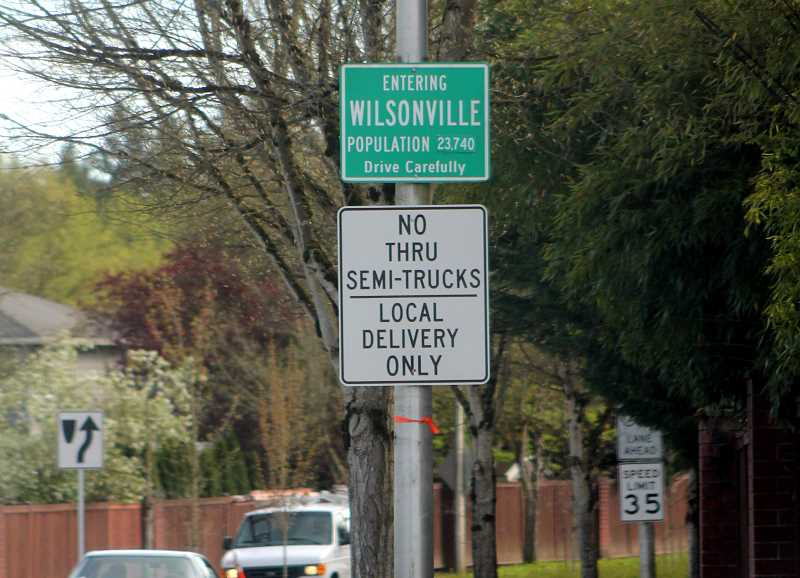 SPOKESMAN PHOTO: CLAIRE GREEN - Signs posted at the intersections of Town Center Loop W and Wilsonville Road and Boeckman/Stafford/Advance/Wilsonville will remain in tact for a longer period of time to better gauge their effectiveness.