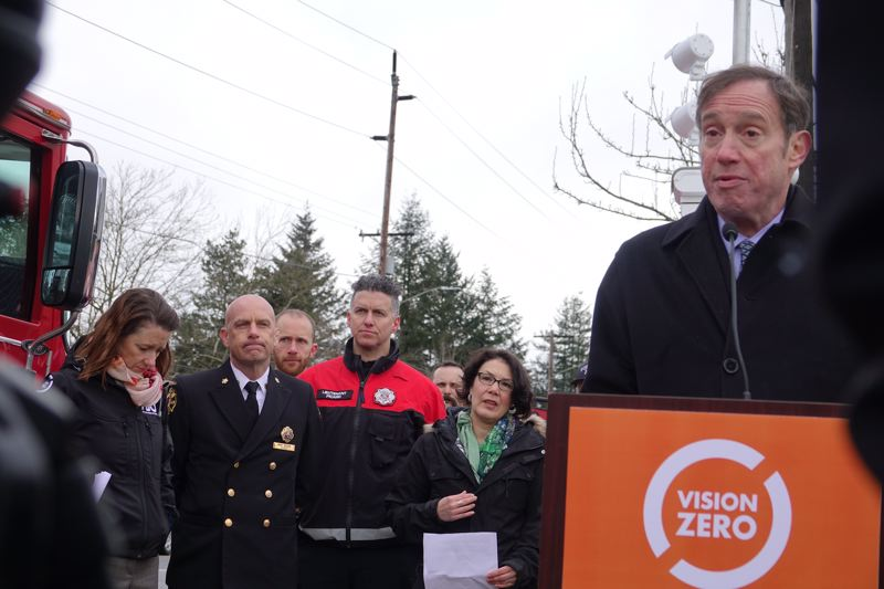 COURTESY PORTLAND BUREAU OF TRANSPORTATION - Portland transportation Commissioner Dan Saltzman would like to install speed and intersection cameras citywide, if state laws can be tweaked to make that possible. He's shown here at a press conference with family members of people killed in crashes and others.