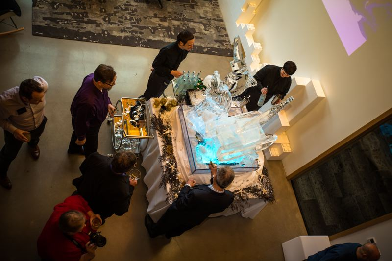 SUBMITTED: CASEY BRAUNGER, ANKROM MOISAN ARCHITECTS - Tom Moisan gets a drink from the ice sculpture of his ship at his Bon Voyage party.