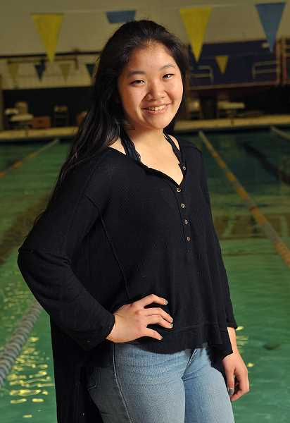 REVIEW PHOTO: VERN UYETAKE - Seventeen-year-old Jenny Kwon volunteers to coach special-needs students on the swim and cross-country teams at LOHS, all while maintaining a 4.34 GPA and staying active in community and school groups.
