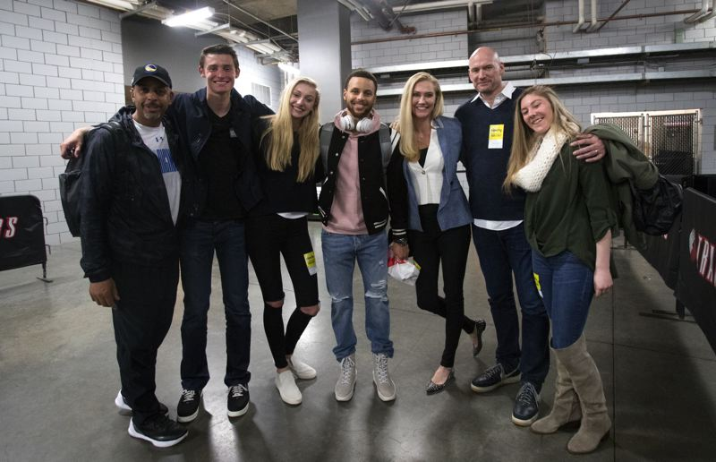 PAMPLIN MEDIA GROUP: JAIME VALDEZ - After Monday's game at Moda Center, a group that is more like family than friends meets near the locker rooms. From left: Dell Curry, Cy Brink, Cameron Brink, Stephen Curry, Michelle Brink, Greg Brink and Kaelin Immel.