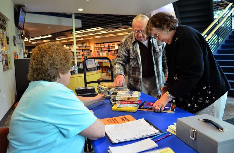 TIDINGS PHOTO: VERN UYETAKE - Jim and Barbara Mixer of West Linn get ready to check out.