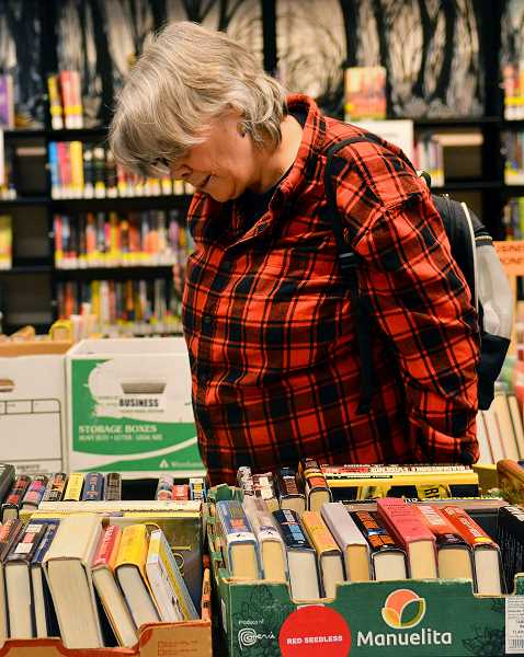 TIDINGS PHOTO: VERN UYETAKE - Sandra Knight searches for some bargains.