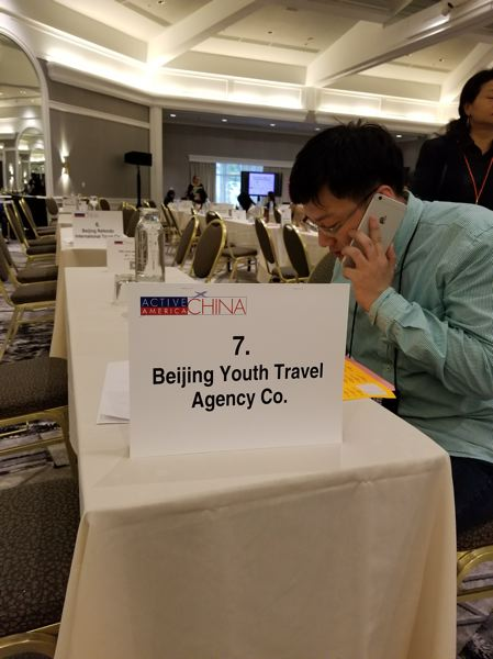 PAMPLIN MEDIA GROUP: JOSEPH GALIVAN - A Chinese buyer grabs a seat in the Hilton and prepares for a series of 15 minute speed dating interviews with Americans about their tourist attractions.