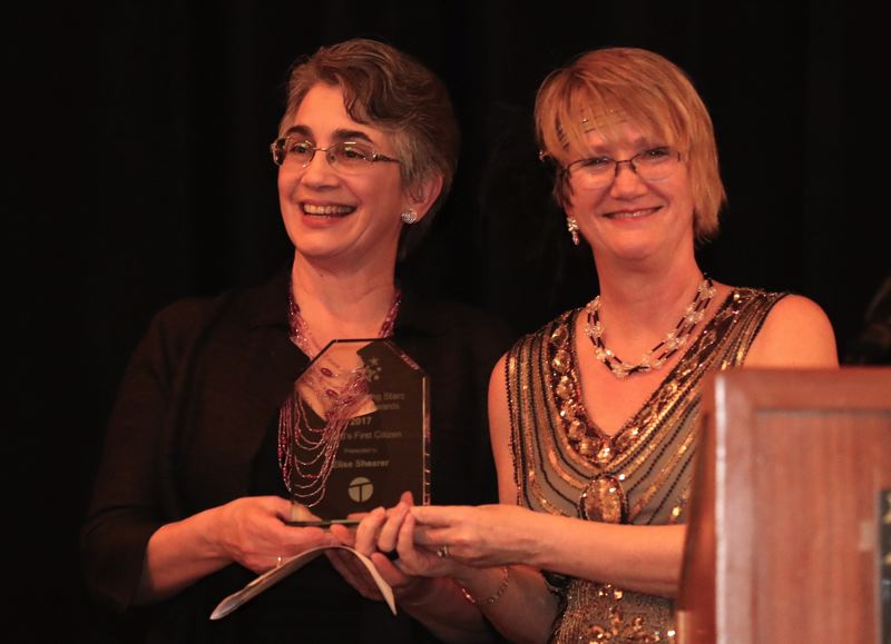 TIMES PHOTO: JAIME VALDEZ - Elise Shearer, left, accepts her award as Tigard's First Citizen from Debi Mollahan, chief executive officer of the Tigard Chamber of Commerce.