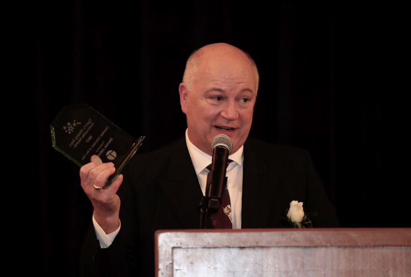 TIMES PHOTO: JAIME VALDEZ - Dennis Johnson, the Tigard Chamber of Commerce's 2017 Chamber Volunteer of the Year and a title sponsor of the Shining Stars Awards Celebration, speaks after receiving his award at the gala.