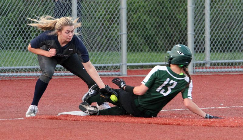 PMG PHOTO: MILES VANCE - Lake Oswego third baseman Marin Penney tries to tag out West Linn's Megan Talbert during her team's 10-0, five-inning loss at Rosemont Ridge Middle School on Friday.