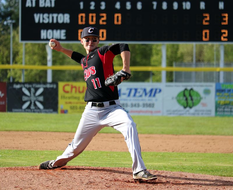 PMG PHOTO: JIM BESEDA - Clackamas pitcher Caden Hennessy cranks it up during his team's Friday win over Oregon City in Mt. Hood Conferece action.