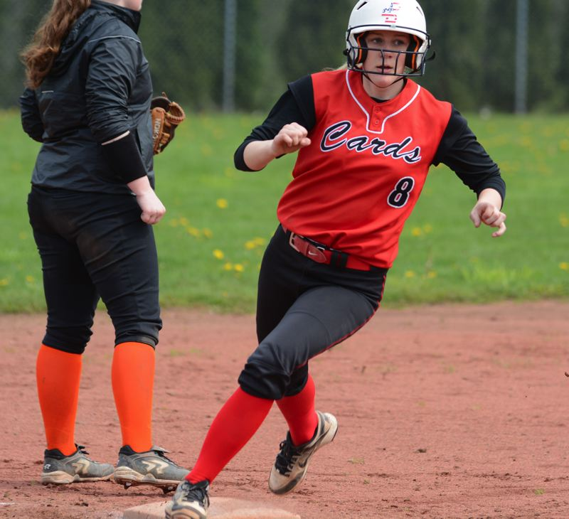 OUTLOOK PHOTO: DAVID BALL - Corbetts Lindsey Flegel rounds third base on her way to scoring the teams first run in Game 2 Saturday.