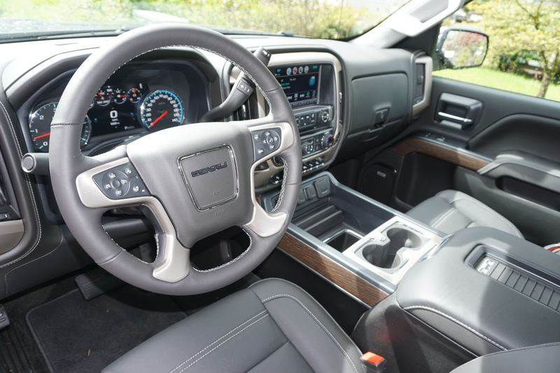 PORTLAND TRIBUNE: JEFF ZURSCHMEIDE - Inside the Denali, you'll enjoy luxury features like active noise cancellation, which monitors engine noise and generates an opposite wave sound through the audio system to cancel out the engine sound.