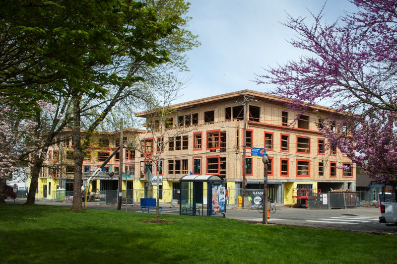 PORTLAND TRIBUNE: DIEGO G DIAZ  - This four-story apartment building has sparked opposition in Multnomah Village. It is being built across the street from where Saturday's town hall was held.