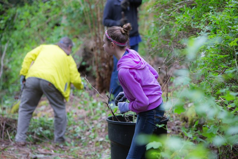 SUBMITTED PHOTO -  Volunteers help clean up the Environmental Learning Center last spring.