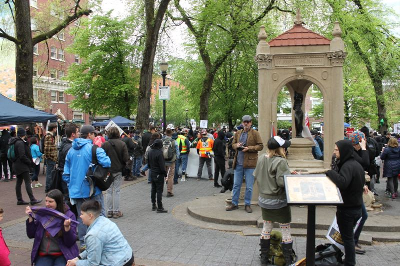 TRIBUNE PHOTO: LYNDSEY HEWITT - More than 1,000 people gathered at Shemanski Park to rally and protest on International Workers Day, Monday, May 1.