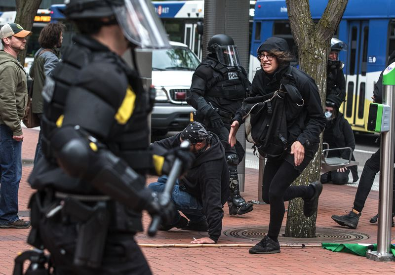TRIBUNE PHOTO: JONATHAN HOUSE - Police and anarchists clashed downtown on Monday, May 1.