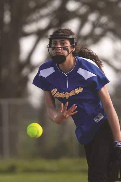 """PHIL HAWKINS - Gervais freshman Isabelle Vasquez had a """"trial by fire,"""" as head coach Dan Saalfeld described it, in a start against the hard-hitting No. 5 Scio Loggers on Friday. Vasquez pitched a complete game in five innings against the Loggers."""