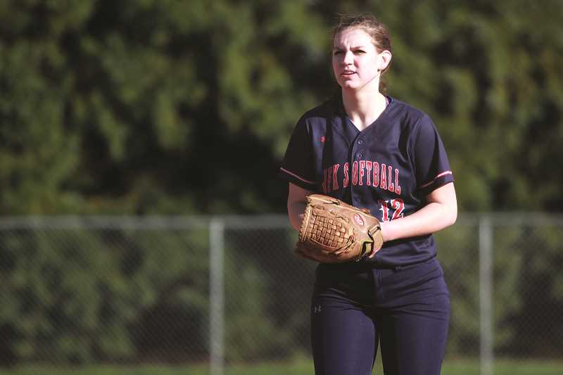 PHIL HAWKINS - Kennedy's returning all-state junior pitcher Tressa Riedman has helped limit opposing 2A/1A teams to just one run scored this season and has a perfect game under her belt against the Regis Rams on April 4.