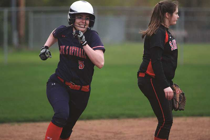 PHIL HAWKINS - Fellow junior Hannah Arritola is one of three all-state defenders that back up Riedman, helping the Trojans hold opponents to just 2.85 runs per game.