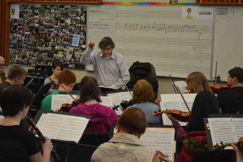 NEWS-TIMES/HILLSBORO TRIBUNE PHOTO: KATHY FULLER - Artistic director Collin Heade rehearses the Westside Community & Youth Orchestra once a week at Hillsboro's Liberty High School.