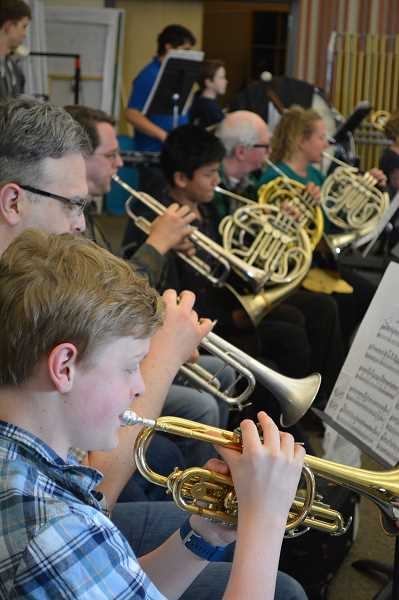 NEWS-TIMES/HILLSBORO TRIBUNE PHOTO: KATHY FULLER - Student and adult musicians play side by side in the orchestra.