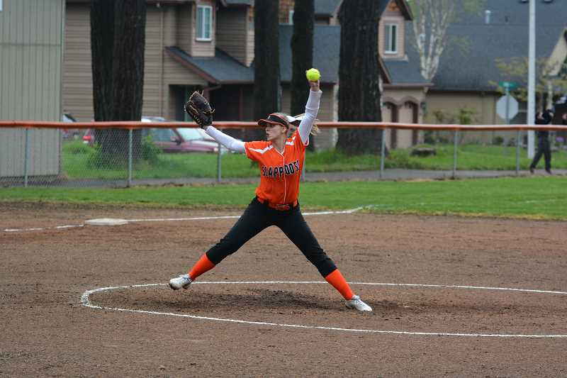 SPOTLIGHT PHOTO: JAKE MCNEAL - Indians junior Nicole Dougherty winds up a pitch against Tillamook.