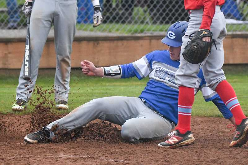 OUTLOOK PHOTO: JOSH KULLA - Gresham's Austen Carpenter scores during a six-run seventh inning for the Gophers Monday in a 12-4 Mount Hood Conference baseball win over rival Centennial.