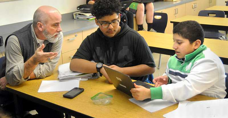 SETH GORDON - Mountain View Middle School assistant principal Donald Johnston works with students Jesus Velasco (left) and Jesus Velasquez on a small group project last month as part of an exercise where he shadowed Velasco for an entire school day.