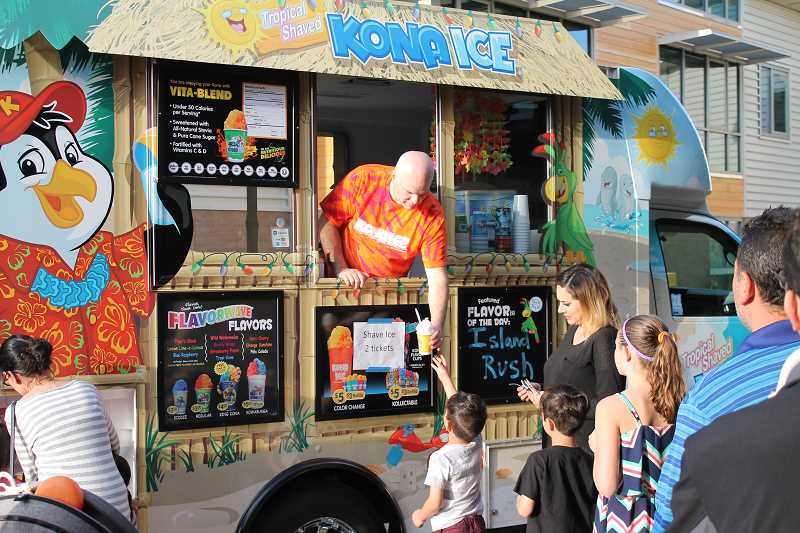 SPOKESMAN PHOTO: ANDREW KILSTROM - Shaved hawaiin ice was a hit at Lowrie's International Festival Friday, April 28.