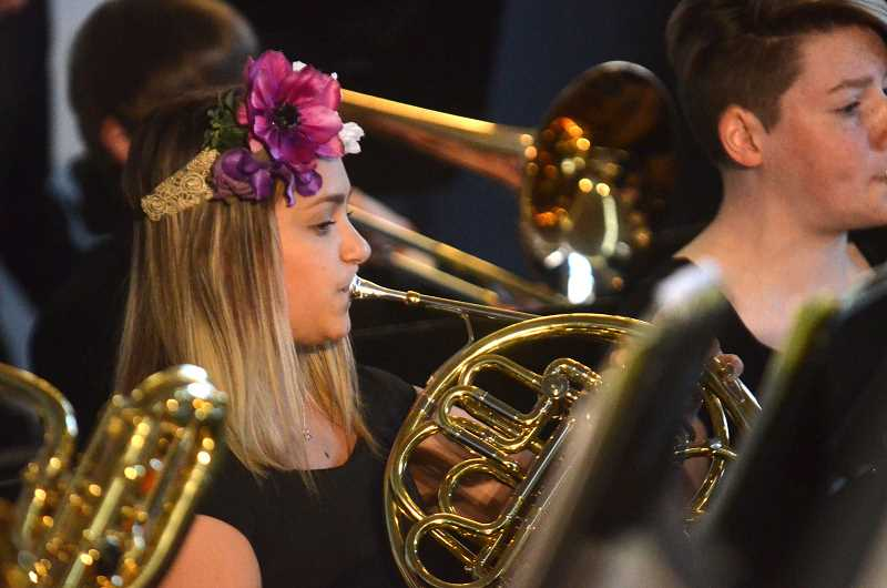 SPOKESMAN PHOTO: VERN UYETAKE - Mia Cassellman and the symphonic band play the opening procession music Friday, April 28 at Wilsonville High.