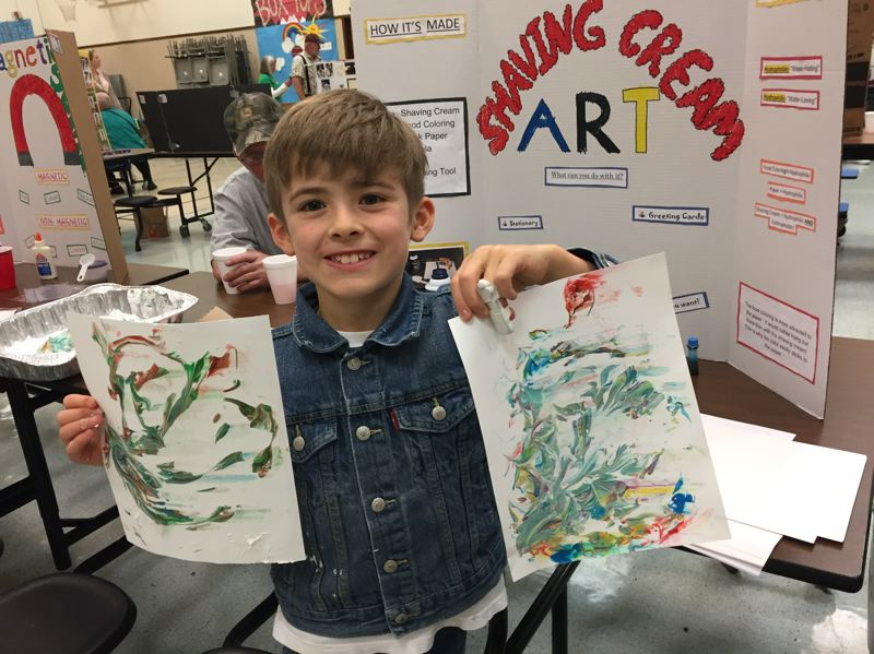 ESTACADA NEWS PHOTO: EMILY LINDSTRAND - Tiki Brown happily shows the colorful results of his shaving cream art project during River Mill Elementary School's Grandparents Day celebration on Friday, April 28.