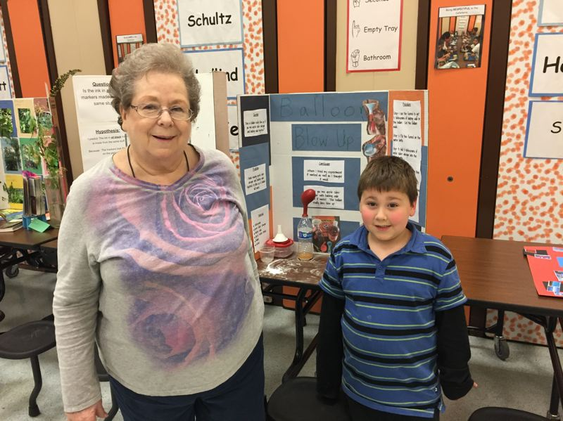 ESTACADA NEWS PHOTO: EMILY LINDSTRAND - Dakota Basine and his grandmother Doris enjoyed looking through the science fair projects during River Mill Elementary School's Grandparents Day celebration on Friday, April 28.